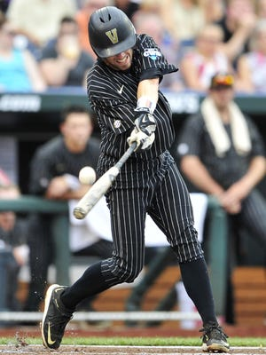 Vanderbilt's Dansby Swanson lines out against Cal State Fullerton on Sunday. Swanson is 0-for-8 in this College World Series.