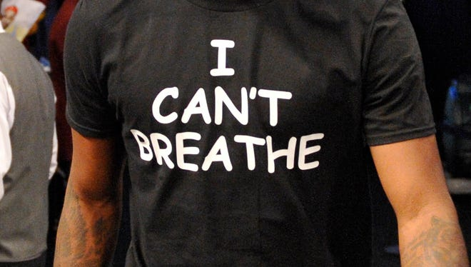 """Jarrett Jack and five other players wore """"I Can't Breathe"""" shirts durin pre-game warm-ups Monday."""