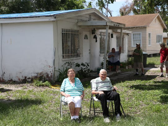 Long-time Fort Myers residents, Ralph,92, and Jackie Hauser,88, sit for a portrait for the News-Press on Thursday. Code enforcement  has cited them for having a blue tarp on their roof. They live with their son Frank on a limited income and can't get it fixed.  Area businesses and friends have rallied around the Hausers. They are getting a new roof, AC and other amenities.