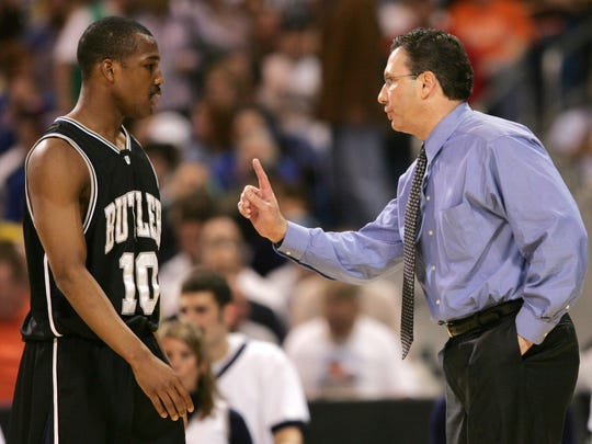 FILE - Ex-Butler coach Todd Lickliter instructs player Mike Green during their 2007 NCAA Division I Men's Basketball Championship Sweet Sixteen game loss to Florida at Edward Jones Dome in St. Louis March 23, 2007.