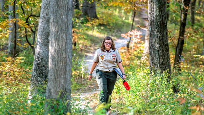 Celeste Saul of Scout Troop 1627 makes her way down a path to help out with a trail reconstruction project she organized for her Eagle Scout project Saturday, Oct. 10, 2020 at Singing Woods Nature Preserve in Peoria County. Saul, a freshman at Illinois State University, will become the first female Eagle Scout in central Illinois.