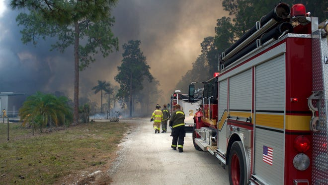 Scenes from a brush fire Friday, April 21, 2017, in Golden Gate Estates.