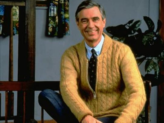 "Fred Rogers poses on the Pittsburgh set of his television show ""Mister Rogers' Neighborhood"" in 1996."