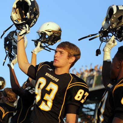Oak Grove players wait for kickoff during a game against