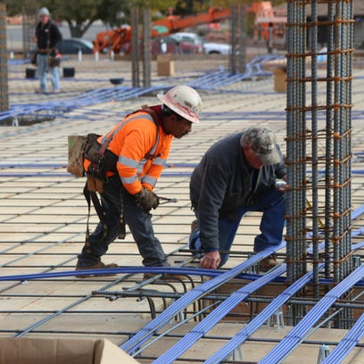 Crews with Bonneville Builders work on a housing project