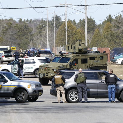 Numerous law enforcement vehicles and SWAT teams respond