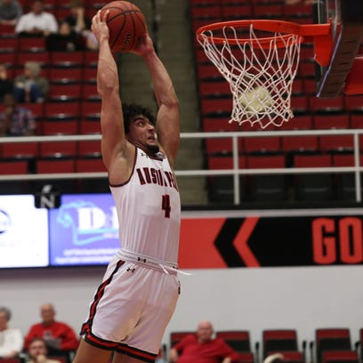 Austin Peay's Dayton Gumm goes up for a dunk early