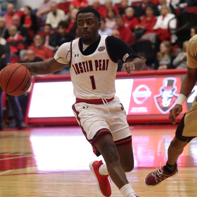 Austin Peay's Tre Ivory directs traffic in the first
