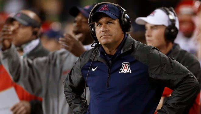 Arizona head coach Rich Rodriguez watches the replay after his team coughed up the ball deep in Oregon territory in the secon quarter of their Pac-12 game in Eugene, Ore., on Oct. 2, 2014.