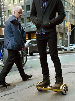This file photo taken on December 15, 2015 shows  Whizboard Store manager 'Mor Loud'demonstrating the Hoverboard in New York. The United States announced on July 6, 2016, the recall of more than a half-million hoverboards after scores of incidents in which the two-wheeled personal transporters erupted in flames. The Consumer Product Safety Commission said the lithium-ion battery packs in hoverboards can overheat, risking them catching fire or even exploding.