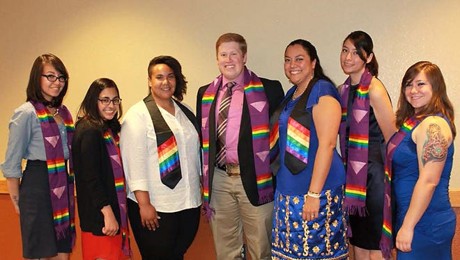 New Mexico State University's LGBT+ Programs hosts the annual Rainbow Graduation Dinner. Pictured here are graduates honored at a previous ceremony.