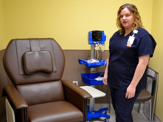 Keisha Harvey, an assistant nurse manager at the Staunton facility, shows off   a home dialysis training area at UVA's new advanced dialysis center in Staunton. The new center allows UVA to offer options not offered at the Augusta facility.