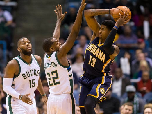 Indiana Pacers forward Paul George (13) passes the