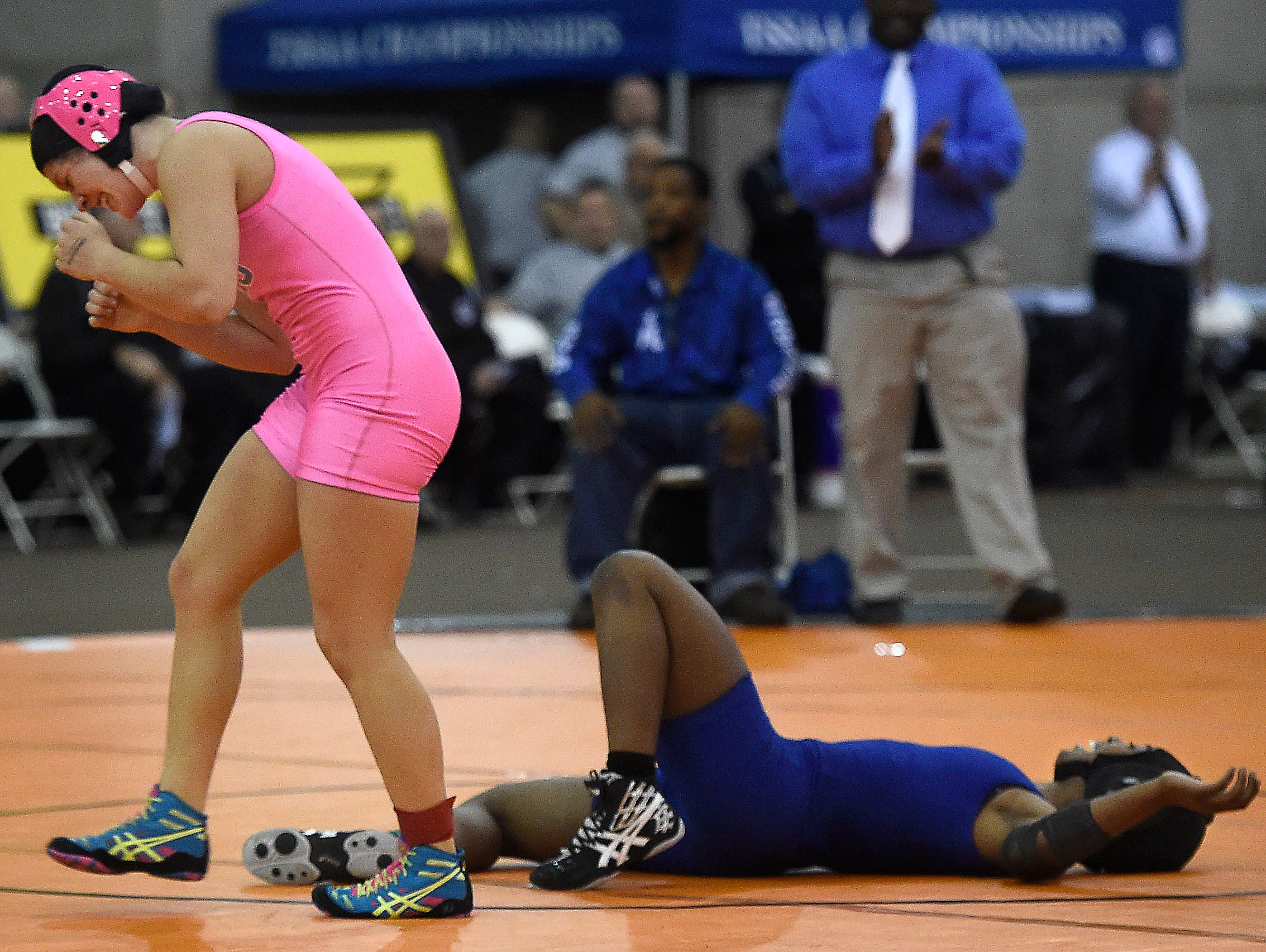 Elise Dille (Cumberland Co.) celebrates her win over Shantoia Blackburn (Antioch) at the TSSAA state wrestling championships Saturday Feb. 20, 2016, in Franklin, Tenn.