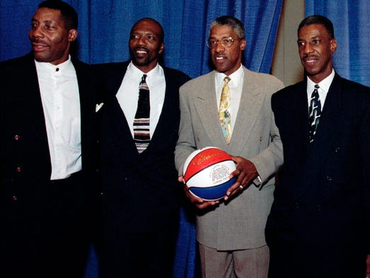 Basketball players from left, Connie Hawkins, Marvin