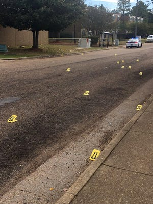 Bullet casings litter Albermarle Road in northwest Jackson after shooting Friday afternoon.