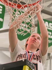 Central York's Emma Saxton (20), cuts the first piece of the net after her team defeated New Oxford 65-50 in the York-Adams League girls' basketball title game in 2017. Emma Saxton and her brother, Sam Saxton, are now both basketball starters at Bloomsburg University, each averaging around 10 points per game. YORK DISPATCH FILE PHOTO