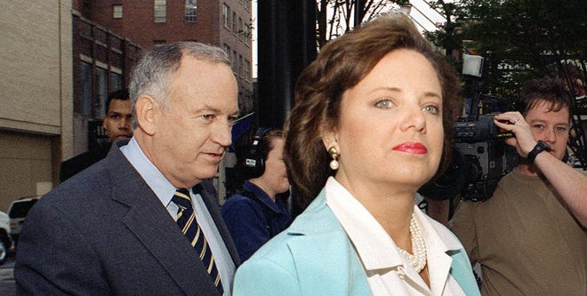 John and Patsy Ramsey arrive at their attorney's office Aug. 28, 2000, to answer authorities' questions about the death of their daughter, JonBenet.
