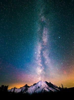The Milky Way seems to emerge like smoke  over Mount Rainier National Park in Washington on July 15, 2015.
