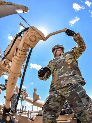 Bravo Battery, with 3rd Battalion, 43rd Air Defense Artillery Regiment, works on raising radars during gunnery.
