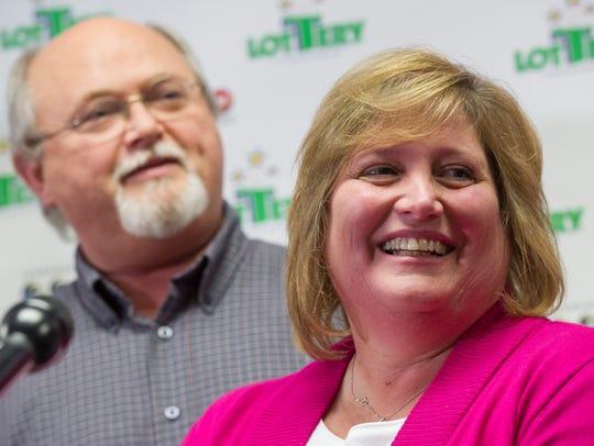Powerball winners John and Lisa Robinson speak during