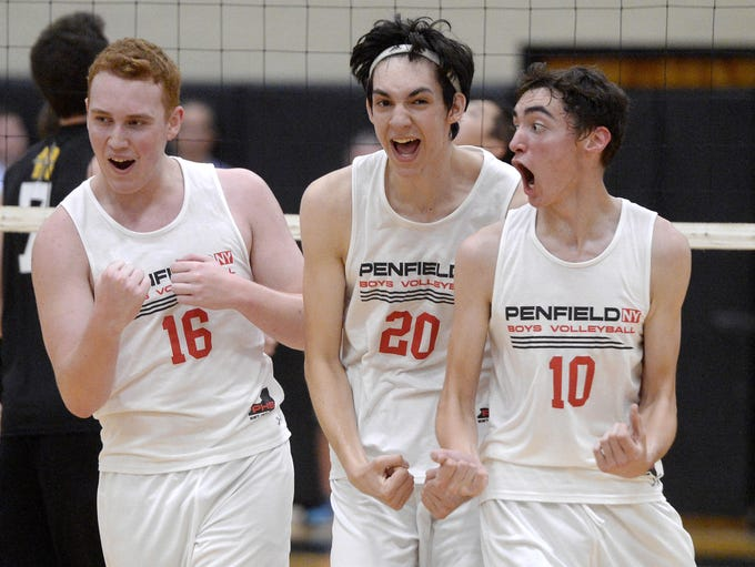 Penfield's Jordan Hildreth, left, Josh Coan, and Adam