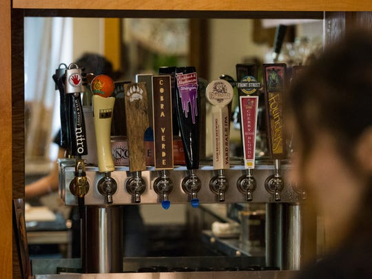 Beer tap handles are seen behind the bar inside Dandy Lion on Tuesday, July 3, 2018. Dandy Lion is now open and will be expanding their hours after pedestrian mall construction is completed.