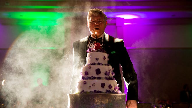 Tom Monaghan, the founder of Ave Maria University, prepares to blow out the final candle on his birthday cake during his 80th birthday celebration at The Ritz-Carlton Golf Resort in North Naples on Saturday, March 25, 2017.