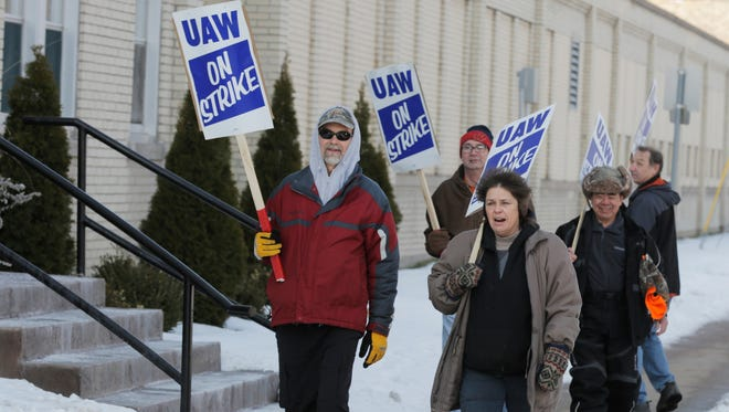 "Workers at AxelTech International went on strike Monday, Feb. 6, 2017, after recent contract negotiations stalled. The United Automobile Workers Local 291 called the strike at 6 a.m. after the union and the company ""failed to reach an agreement by the Jan. 29 contract expiration deadline,"" according to a union news release. About 60 employees carried signs and marched along sidewalks in front of the company's facility, 1005 High Ave., near the University of Wisconsin-Oshkosh campus."