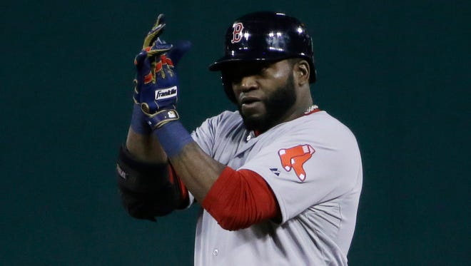 David Ortiz reacts after hitting a RBI double in the first inning to give the Red Sox a 1-0 lead.