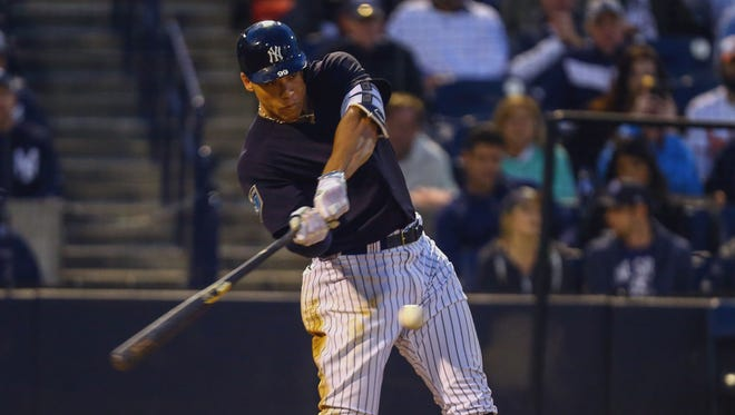 Yankees right fielder Aaron Judge hits a home run during the fourth inning of a Spring Training baseball game against the Baltimore Orioles at George M. Steinbrenner Field.