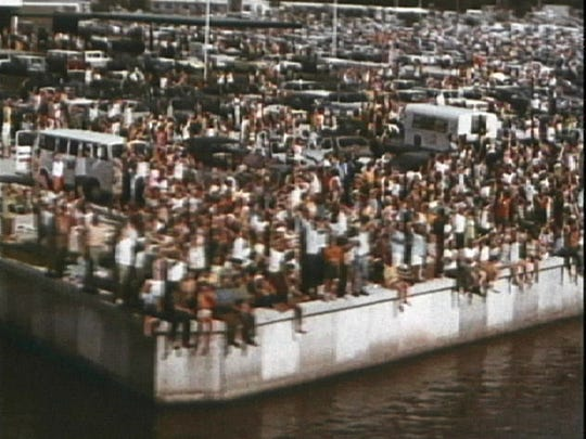 On July 16, 1969, crowds gather outside the former