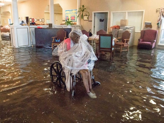A patient waits for rescue from a health care facility in Port Arthur, Texas on Aug. 30, 2017, that was flooded after Hurricane Harvey. ÒOur whole city is underwater,Ó Mayor Derrick Freeman said.