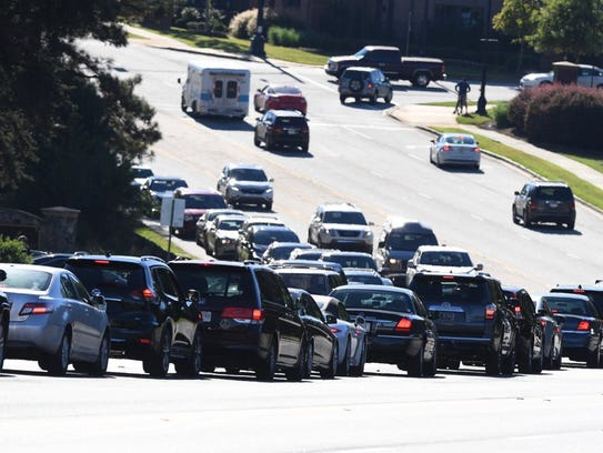 Lines of vehicles back up on Verdae Boulevard in Greenville