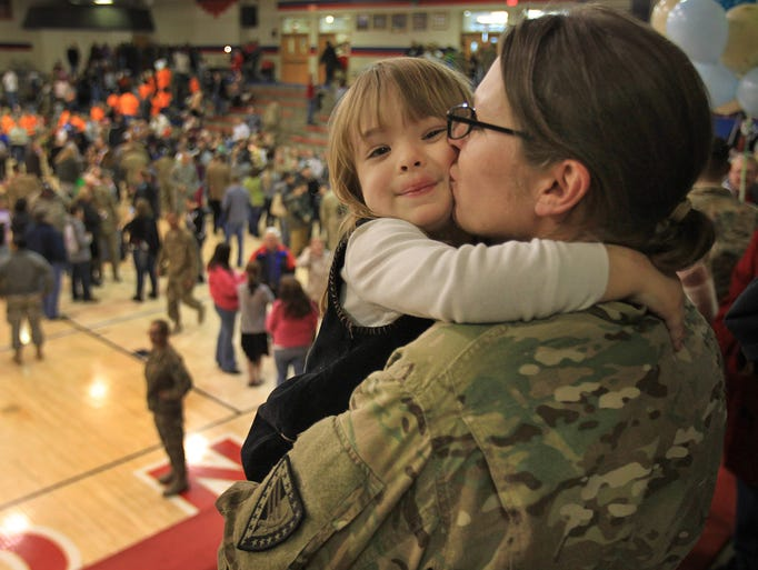 """I missed you so much,"" said Cassandra Boner, 3, left, as she hugs her mother Emily Boner, at the homecoming of Army National Guard 1438 Transportation, Wednesday, December 11, 2013, at Indian Creek High School in Trafalgar.  This was Emily Boner's third deployment, but her first since Cassandra was born."
