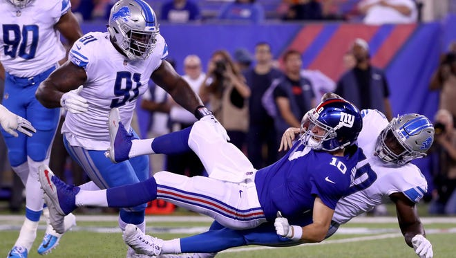 Lions LB Jarrad Davis sacks Giants QB Eli Manning in the first half of the Lions' 24-10 win on Monday, Sept. 18, 2017, in East Rutherford, N.J.