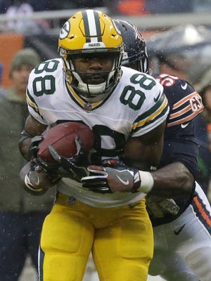 Green Bay Packers running back Ty Montgomery (88) makes a seven yard reception before being wrapped up by Chicago Bears inside linebacker Christian Jones (52) during the first quarter of their game Sunday, November 12, 2017 at Soldier Field in Chicago, Ill.
