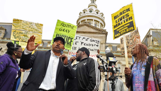 """Edward Brown speaks at a protest outside City Hall about Freddie Gray in Baltimore, Monday, April 20, 2015. Baltimore's top police officials, mayor and prosecutor sought to calm a """"community on edge"""" Monday while investigating how Gray suffered a fatal spine injury while under arrest. Six officers have been suspended, but investigators say they still don't know how it happened. (Amy Davis/The Baltimore Sun via AP)"""