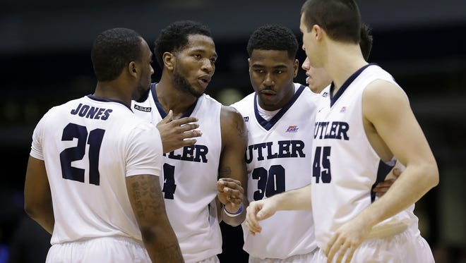 The Butler Bulldogs Butler Bulldogs forward Roosevelt Jones (21), Tyler Wideman (4),  Kelan Martin (30), Kellen Dunham (24) and Andrew Chrabascz (45) huddle together in the second half of the Big East Conference basketball game Tuesday, Feb 16, 2016, evening at Hinkle Fieldhouse. The Butler Bulldogs defeated the Creighton Bluejays 88-75.