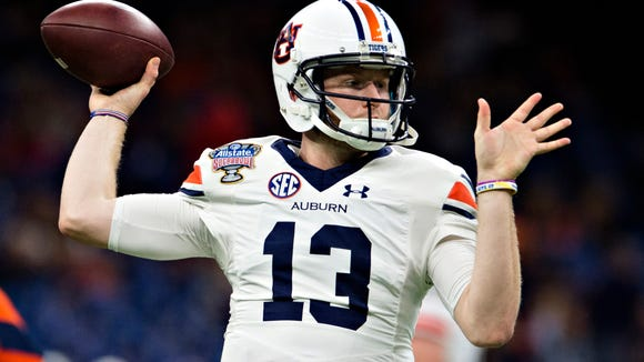 Auburn quarterback Sean White (13) throws a pass before the Sugar Bowl between Auburn and Oklahoma on Monday, Jan. 2, 2017, at the Super Dome in New Orleans, La.