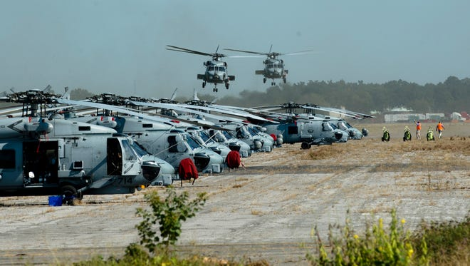 U.S. Navy Blackhawk helicopters land at Maxwell Air Force Base in Montgomery, Ala., on Friday, Sept. 8, 2017. The helicopters came from Florida and were flown in to be protected from Hurricane Irma.