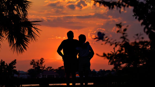 """Everyone talks about Key West, but this is better,"" said Don Dadko of Stuart as he and his wife, Sally, of 40 years watch the sunset at Shepard Park in Stuart on Sept. 13, 2005. They were on their way to dinner when they noticed the upcoming spectacle. ""It was gorgeous,"" said Sally with a smile."