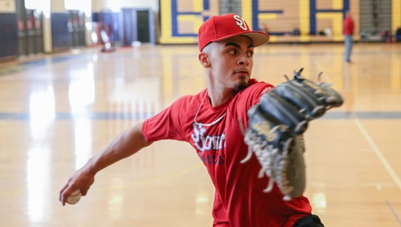 Beacon right hand pitcher Lenny Torres throws on Thursday,