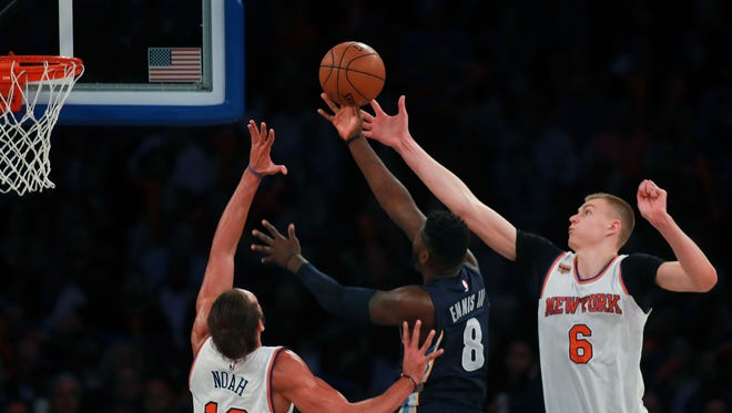 James Ennis #8 of the Memphis Grizzlies puts up a layup defended by Kristaps Porzingis #6 and Joakim Noah #13 of the New York Knicks during the second half at Madison Square Garden on October 29, 2016 in New York City. NOTE TO USER: User expressly acknowledges and agrees that, by downloading and or using this photograph, User is consenting to the terms and conditions of the Getty Images License Agreement.