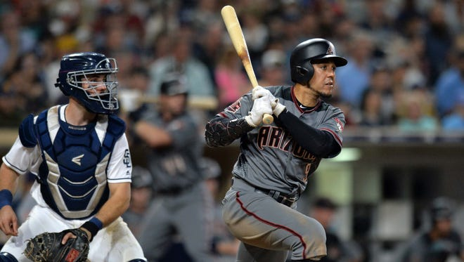 Jul 28, 2018: Arizona Diamondbacks right fielder Jon Jay (right) hits a two run double during the eighth inning in front of San Diego Padres catcher Austin Hedges at Petco Park.