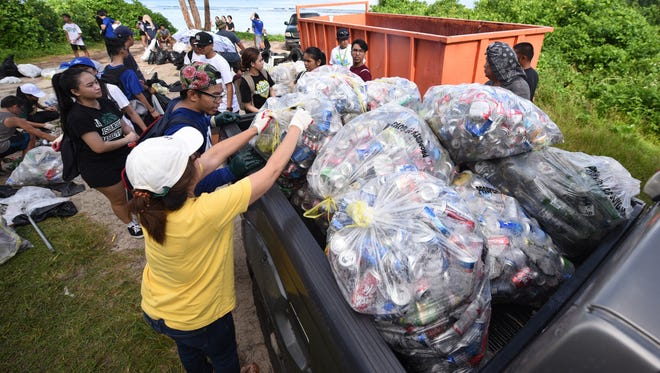 A Guam Environmental Protection Agency pickup is loaded with bags of aluminum cans and glass bottles at Tanguisson Beach during the 23rd Annual Guam International Coastal Cleanup 2017 near the Okkodo High School in Dededo on Saturday, Sept. 16, 2017.