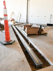 Floor drains are being installed Monday, April 11, for the new brewing tanks at the new Urban Moose Brewing Co. brewpub and taproom in Sauk Rapids. The brewery will be at the site of the former Sauk Rapids American Legion Hall, 415 Benton Drive N.