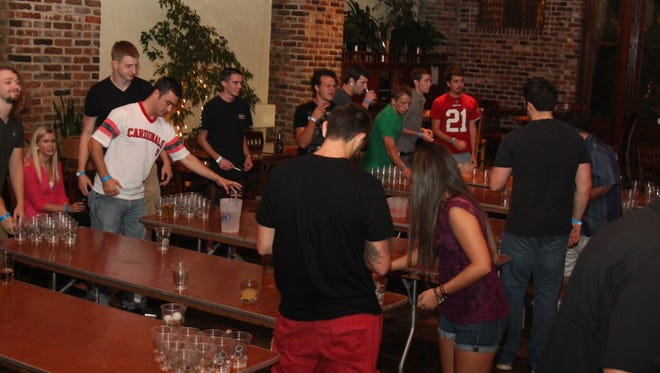 Free beer pong is part of the fun during College Night at Seville Quarter.