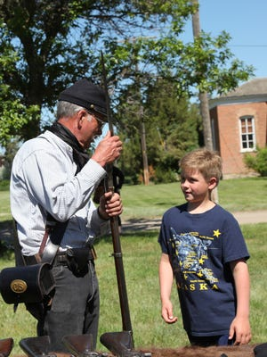Reenactors dress in period clothes to bring history to life on Living History Day in Havre June 3.