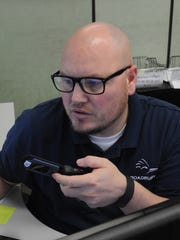 Dispatcher Shane Bollar is on a call for Roadrunner Shuttle and Limousine Service.